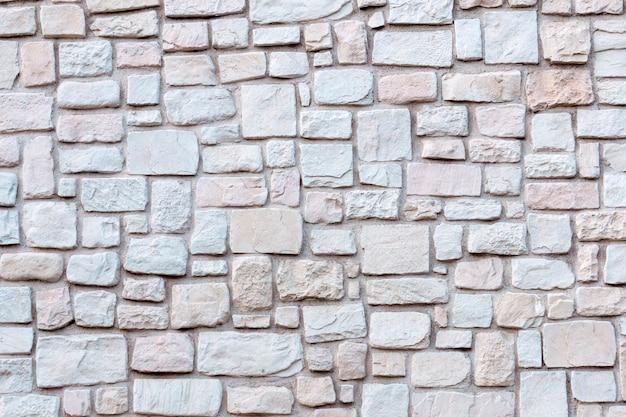Alter steinmauerwerk hintergrund steinmauer textur und muster