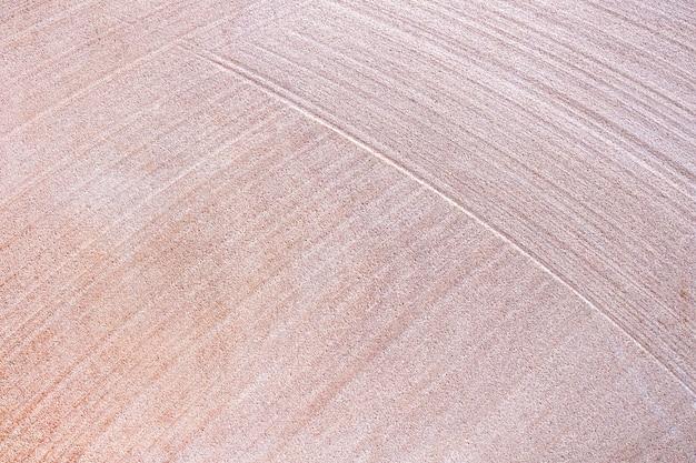 Alter steinwand-beschaffenheitshintergrund des roten sandes. fußboden
