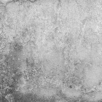 Alter und schmuddeliger betonwandhintergrund