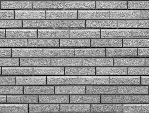 Alter verwitterter schmutziger zementbacksteinmauer-beschaffenheitsoberflächenhintergrund.