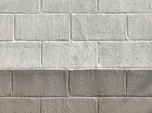 Alter verwitterter zementbacksteinblockwand-beschaffenheits-oberflächenhintergrund der farbe schmutziger.