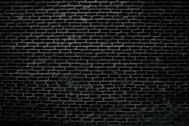 Altes altes abstraktes muster der schwarzen backsteinmauer