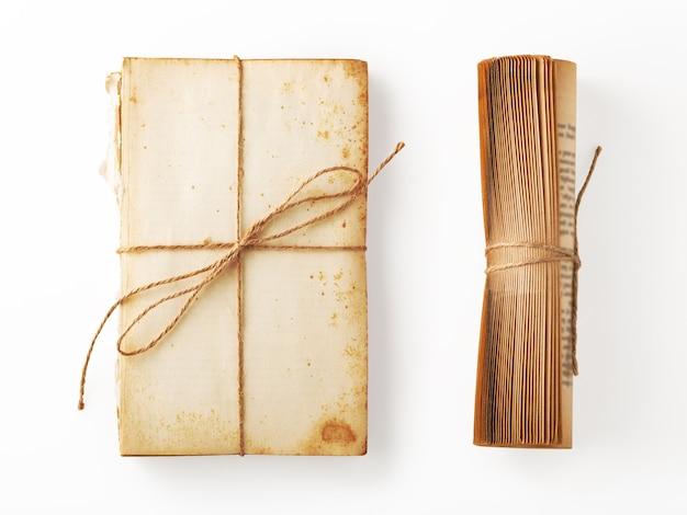 Altes buchpapier und vintage-buchrollendekor