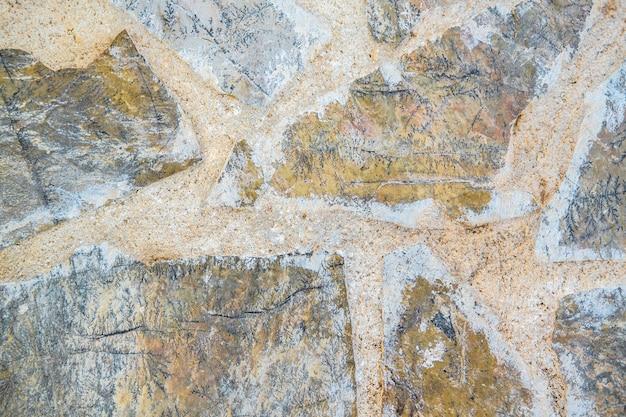 Altes mauerwerk an der wand. strukturierter hintergrund
