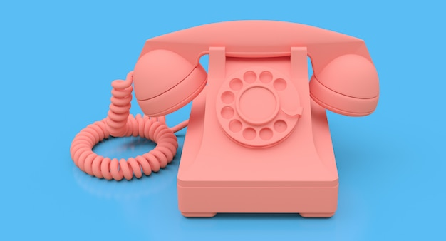 Altes rosafarbenes vorwahlknopftelefon auf einer blauen oberfläche