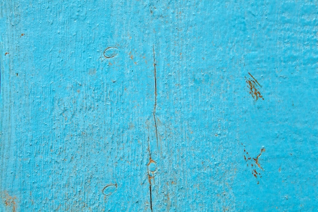 Altes schäbiges holzbrett, hellblau gestrichen.
