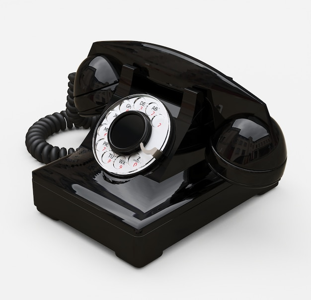 Altes schwarzes vorwahlknopftelefon auf einem weißen hintergrund