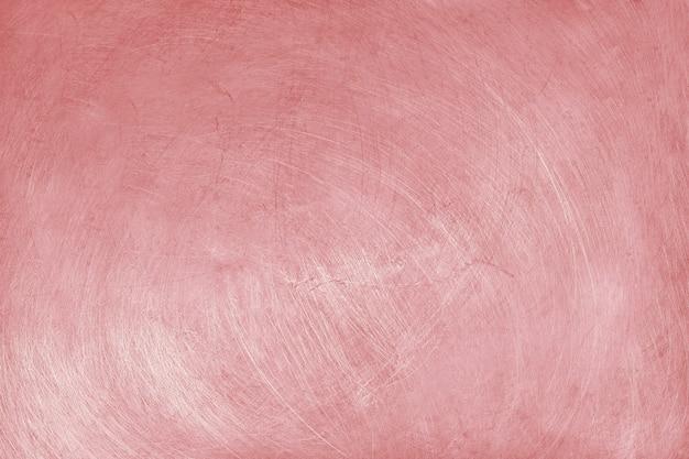 Aluminiumbeschaffenheitshintergrund mit rosengoldfarbe, muster von kratzern auf edelstahl.