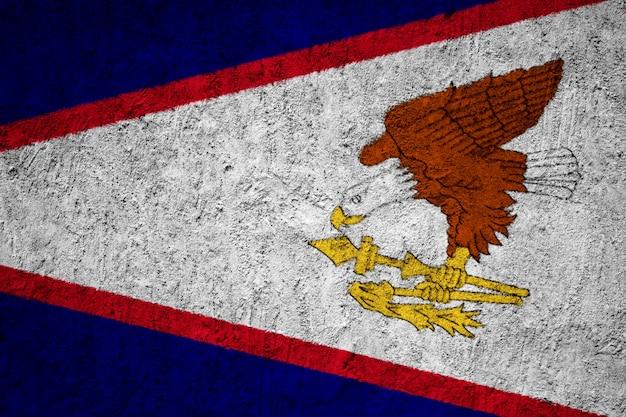 Amerikanisch-samoaflagge gemalt auf schmutzwand