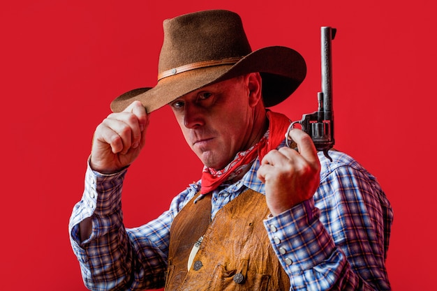 Amerikanischer cowboy cowboy trägt hut westliches leben kerl im cowboyhut amerikanischer bandit in maske westlicher mann mit hut