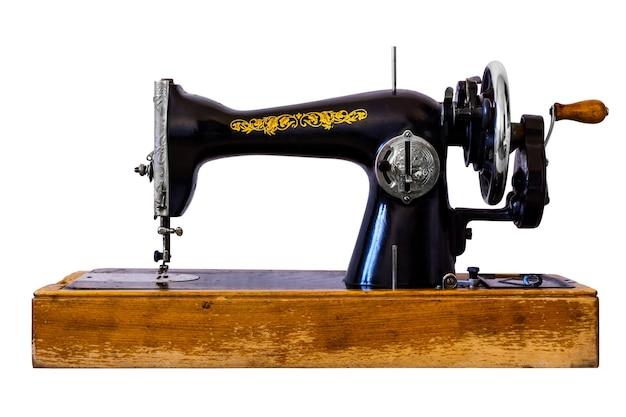 Antike nähmaschine isoliert auf weißem hintergrund