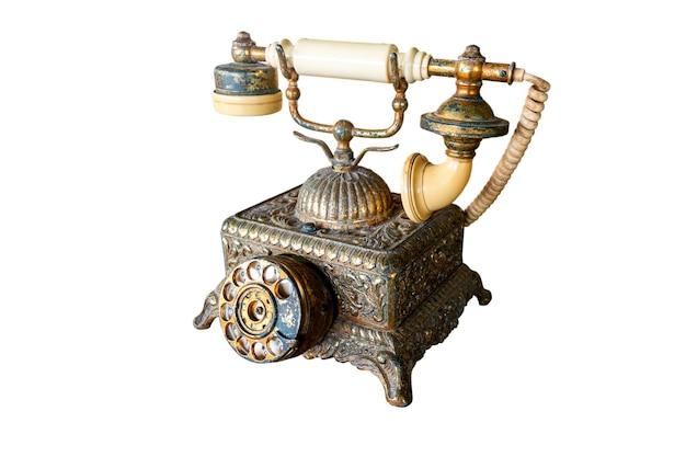 Antikes telefon isoliert auf weißem hintergrund. datei enthält mit beschneidungspfad so einfach zu arbeiten.