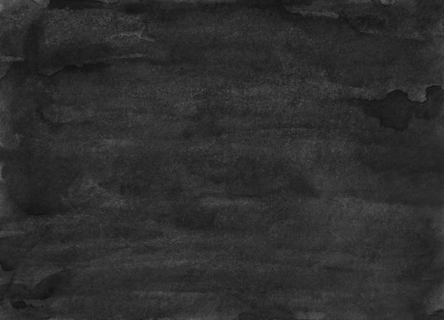 Aquarell alte schwarze hintergrundbeschaffenheit. dunkles monochrom. abstrakte aquarellmalerei. flecken auf papier.