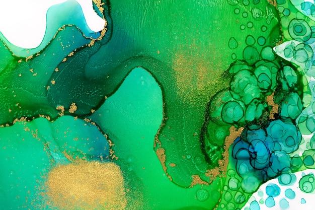 Aquarell chaotischer spray abstrakter kunstwerk hintergrund mit tropfen und goldglitter