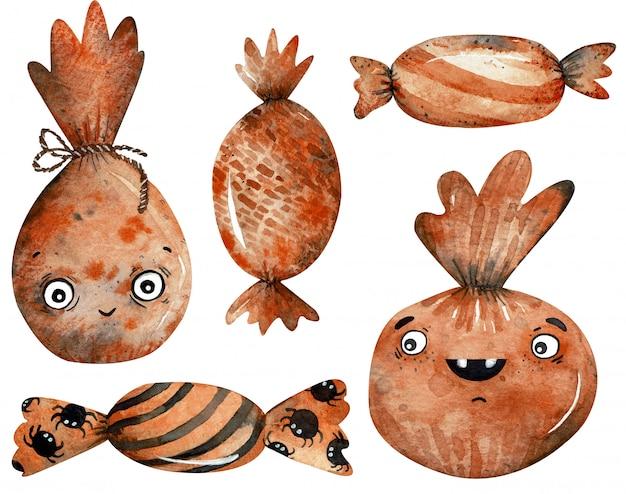 Aquarell clipart von schwarzen und orange bonbons und von süßigkeiten halloweens lokalisiert
