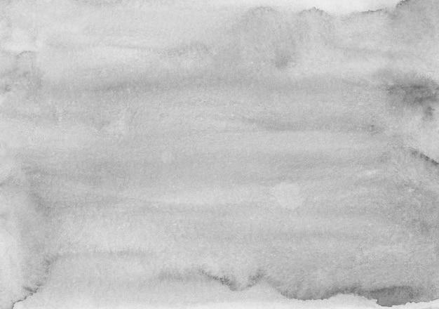 Aquarell hellgraue hintergrundmalerei textur. monochrome flecken auf papierauflage. moderne abstrakte schwarzweiss-aquarellkunst.