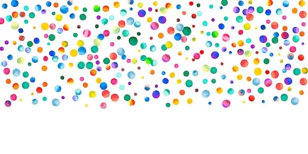 Aquarell konfetti auf weißem hintergrund. lebendige regenbogenfarbene punkte. fröhliche feier breite bunte helle karte. ordentliches handbemaltes konfetti.