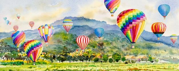 Aquarell-landschaftsmalerei, die bunt von heißluftballon auf dorf, berg im panorama-ansichtshimmel malt.