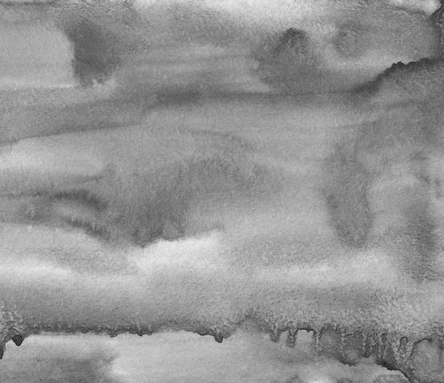 Aquarell ruhige graue flüssige hintergrundbeschaffenheit. monochrome flecken auf papierauflage. abstrakte schwarzweiss-aquarellmalerei.