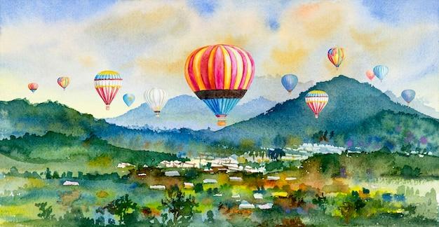 Aquarelllandschaftsmalerei, die bunt von der heißluftballonfahrt auf dorf, berg in der panoramaansicht und in der ländlichen gesellschaft der emotion, naturfrühling im himmelhintergrund malt.