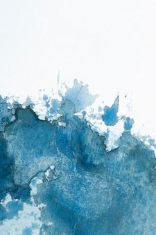 Aquarellspritzer auf papierstruktur