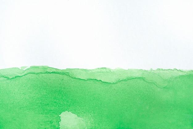 Aquarellspritzer auf papierstrukturzusammensetzung