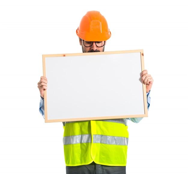 Arbeiter mit leeren schild