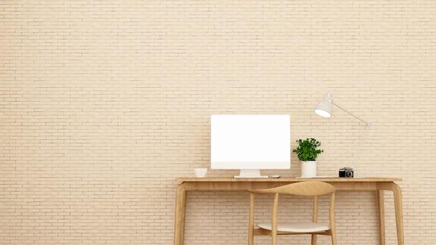 Arbeitsplatz und cremefarbene backsteinmauer schmücken.
