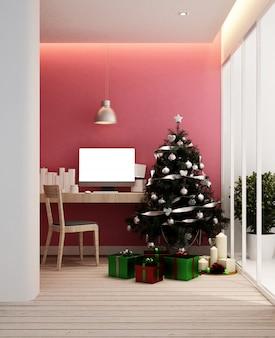 Arbeitsplatz und weihnachtsbaum in der wohnung oder zu hause