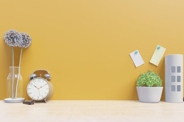 Arbeitstabelle mit dekoration auf gelbem wandhintergrund der schreibtischrückseite