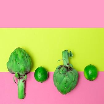 Artischocke und limette. minimalistisches veganes designkonzept