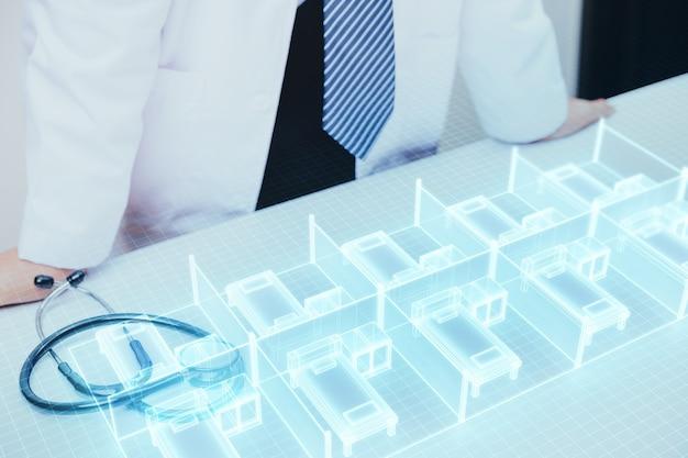 Arzt plant, ein temporäres krankenhausbett auf dem feldkrankenhaus zu bauen, um mit großen ausbrüchen wie covid-19 in der hologrammtechnologie fertig zu werden.