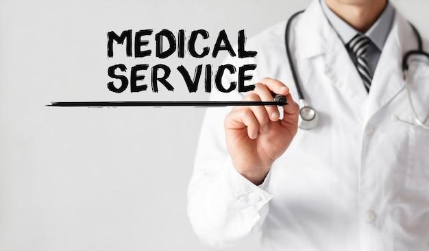 Arzt schreibt wort medical service mit marker, medizinisches konzept
