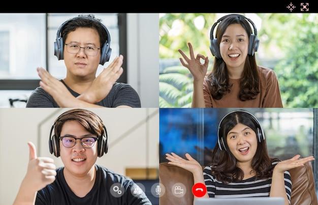 Asiatische geschäftsleute treffen und stimmen mit teamwork-kollegen im videoanruf-konferenzbildschirm ab