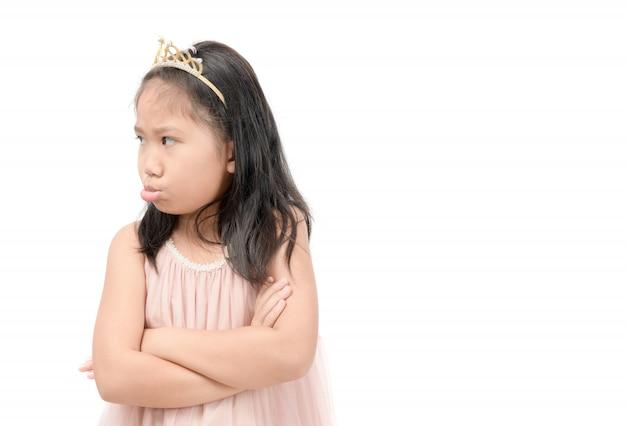 Asiatische kindergefühlbelastung oder gelangweilt lokalisiert auf weiß