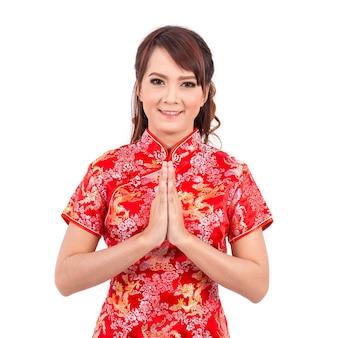 Asiatischer chinesischer Mädchengruß auf traditionellen Chinesen, Willkommen, Gast, setzen Sie die Palmen
