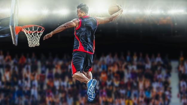Asketball spieler, der einen athletischen slam dunkschuß erzielt