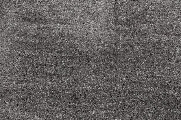Asphalt mit feinkörniger textur. nahaufnahmefoto