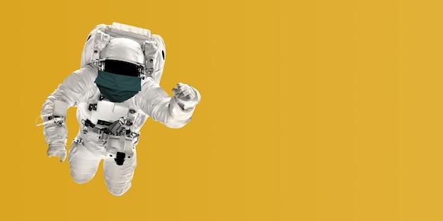 Astronaut fliegt maskiert über den trend 2021 hintergrund coronavirus und luftverschmutzung pm2.5 konzept. covid-19. elemente dieses von der nasa bereitgestellten bildes