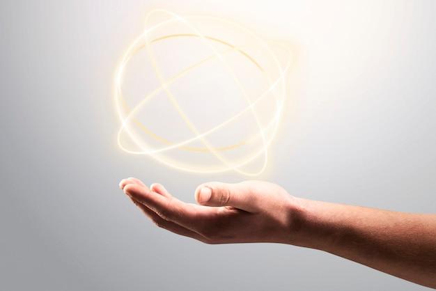 Atom-hologramm-hintergrund, der auf der hand des mannes wissenschaftstechnologie-remix zeigt