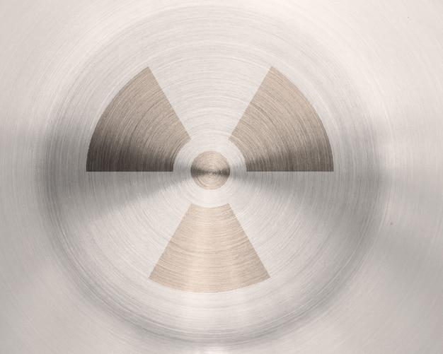 Atomzeichen des schmutzes auf metallbeschaffenheitshintergrund
