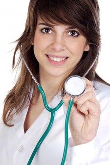 Attraktiver damedoktor über einem weißen hintergrund