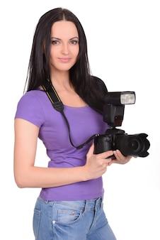 Attraktiver frauenphotograph bei der arbeit