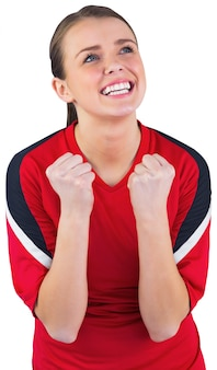 Aufgeregtes fußballfan im roten zujubeln