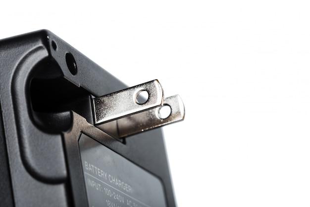 Aufladeeinheit für digitale fotokameras auf getrenntem weiß