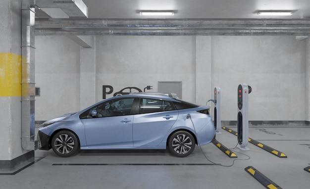 Aufladen des 3d-elektroautos auf dem parkplatz