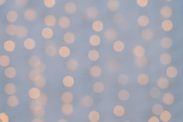 Aus fokusfeiertagshintergrund mit unscharfem licht heraus