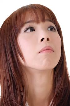 Ausdruck der sorge, nahaufnahmeporträt des asiatischen geschäftsfrauengesichtes.