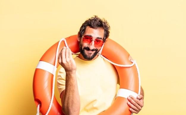 Ausdrucksstarker verrückter mann, der eine capice- oder geldgeste macht und ihnen sagt, dass sie bezahlen sollen. rettungsschwimmer-konzept