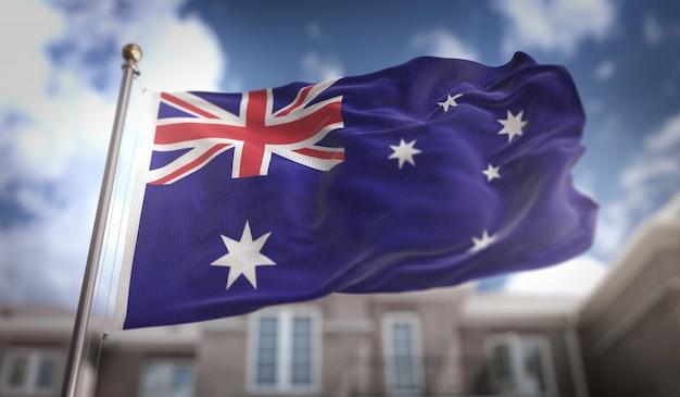 Australien flagge 3d rendering auf blauem himmel gebäude hintergrund